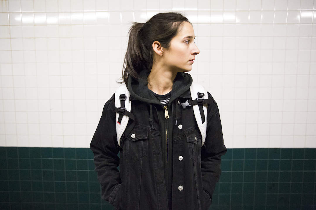 Cassie Lavo standing at NYC subway platform.